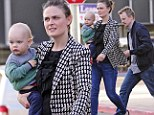 Hey, wait for me! Emily Deschanel totes baby Henry to lunch while husband David Hornsby struggles to keep up