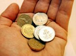 Cash in hand: Regular savers can earn up to 3.28 per cent after tax for 12 months with the West Bromwich