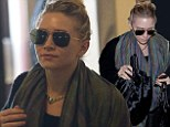 Hair up: Ashley wore her blonde hair up in a little bun as she arrived on Friday at LAX in an uninspired outfit