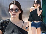 Catwalk ready! Kendall Jenner shows off her model pins in denim shorts after trip to the hair salon