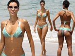 Wow! Nicole Murphy showed off her sculpted physique as she vacationed in Hawaii with her fiance Michael Strahan