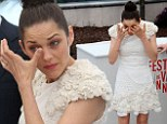 Tears of relief? Marion Cotillard sheds tears a photo call in Cannes... after her stalker is put on probation