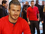 Life after football... David Beckham gets back to his day job as he signs H&M pants in Paris