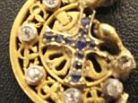 A python hunter who found this gold, diamond and sapphire pendant hopes to reunited it with the rightful owner, or their living heir