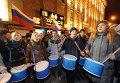 Pro-Kremlin youth group members beat drums and chanted 'Russia! Putin!'