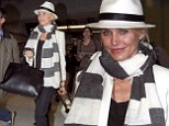 Hat's one put together look! Cameron Diaz matches her trilby, scarf and jacket as she arrives at the airport