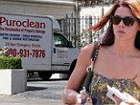 Ashley Greene shows off toned arms in floral romper as cleaning truck is spotted outside her fire-ravaged apartment