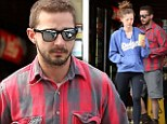 Sleepy Shia: LaBeouf and his girlfriend Mia Goth step out for an early morning groggy coffee run