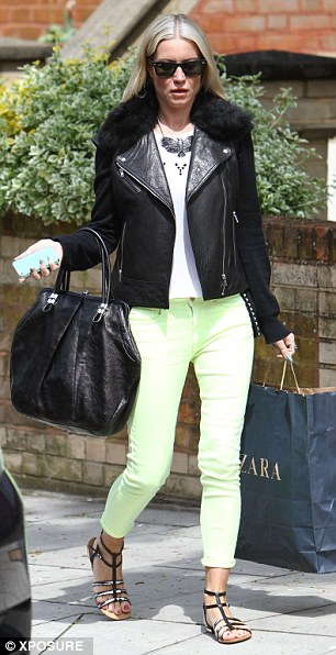Sensible dressing: Denise wore sandals but also kept warm with a fur collar on her leather jacket