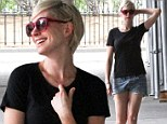 Is that really her? Anne Hathaway goes from cut-off locks to tiny cut-off denim shorts... and giggles her way to a wardrobe win