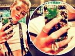 Seeing green... Miley Cyrus posed a picture of herself to Twitter with a marijuana leaf on her cell phone cover