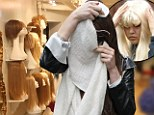 Shopping for a new look: Amanda Bynes wrapped her face in a scarf as she stepped into a few wig shops in New York City's West Village on Saturday