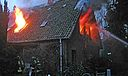 This picture shows the blaze that ripped through a wooden farm house at Walsrode in Germany and claimed the life of an eight-year-old boy.