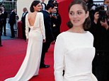 Marion Cotillard looked incredible in a white dress as she hit the Cannes Red Carpet on Friday