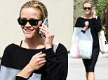 Sly smile: Reese Witherspoon flashed a grin on Friday after shopping in Los Angeles