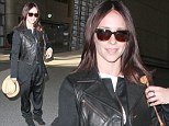 What was she thinking? Jennifer Love Hewitt drowns her curves in BIZARRE baggy trousers as she jets to Paris
