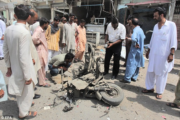 Scene: The twin blasts in Karachi, Pakistan, ahead of today's landmark poll left at least 11 people dead, according to early reports