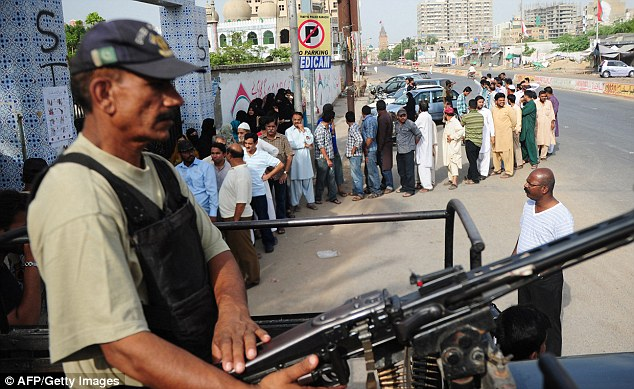 Violence: Twin explosions killed nine people in Pakistan today as people flooded to the polls to vote in the country's landmark election