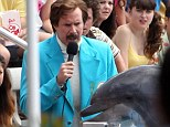 A man with a porpoise! Will Ferrell is all business as he films Anchorman 2 scene with dolphin