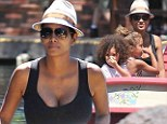 A trip to the happiest place on Earth! Halle Berry flaunts her growing baby bump in a clingy maxi as she and daughter Nahla spend the day at Disneyland