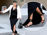 Not the smartest choice! Heavily pregnant Kim Kardashian tries to stay composed as she awkwardly stumbles over own dress