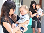 He's so silly! Selma Blair's little boy gets a fit of the giggles during mother-son shopping trip
