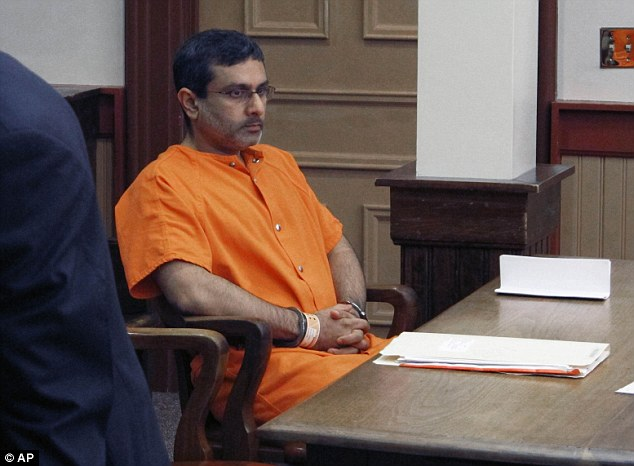 In court: Dr. Ali Salim, pictured, waits for deputies to escort him from the courtroom after he pleaded not guilty to charges of killing Ballman on Thursday