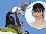 Milla struggles with a hawk while in Cannes