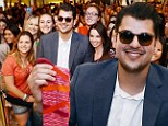 Rob Kardashian wears shades and hides his shrinking frame behind a desk at Las Vegas sock launch