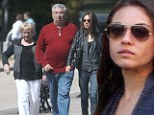 Not so lonely now! Mila Kunis' parents keep her company during London stroll without Ashton Kutcher