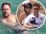 Going my way? Russell Crowe takes bikini-clad blonde on a spin around Mykonos after cooling off in the Aegean Sea