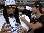True bromance! Taylor Lautner and Lil Jon hug it out together at baseball game