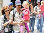 Enchanted by our girl! Amy Adams and her fiancé dote over daughter on a fun day out