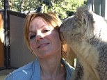New pal: Geri Halliwell posed up with a koala when she visited the zoo in Australia on Sunday