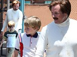 Break time! Will Ferrell, left, took his sons Magnus and Mattius to play with the dolphins at Sea World in San Diego, CA on Friday, between takes for Anchorman 2