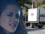 The final goodbye, Kristen Stewart watches on sadly as moving trucks take away the last of Robert Pattinson's belongings