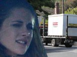 The final goodbye, Kristen Stewart watches on sadly as moving trucks take away the last of Robert Pattinson's belongings
