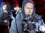 Trying to focus! Ryan Gosling gets serious behind the camera as he directs scene for his new film