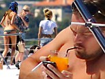 The life of Leo: DiCaprio establishes himself as Hollywood's number one playboy surrounding himself in a bevvy of scantily clad women aboard a luxury yacht