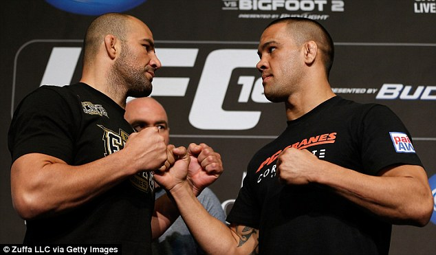 Raring to go: Opponents Glover Teixeira and James Te-Huna face off ahead of their Vegas showdown