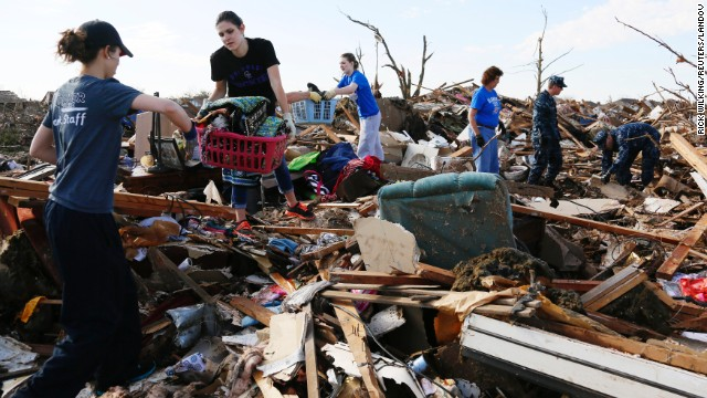 Volunteers form a chain to retrieve clothing and other household items on May 22.