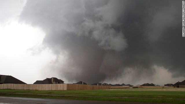 A massive tornado approaches Moore on May 20. The storm first touched down to the west of the city near Newcastle, Oklahoma. Visit <a href='http://www.cnn.com/SPECIALS/impact.your.world/'>CNN.com/impact</a> for ways to help the victims.