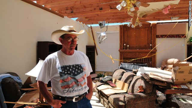 """George Stanley recorded the tornado on his iPhone before waiting out the storm in his neighbor's underground storm shelter. He doesn't plan to leave. """"It's my paradise out here,"""" he said."""