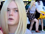 Mixing prints: Elle Fanning wore a striped T-shirt and floral-printed skirt as she headed towards Cakemix in West Hollywood, California on Saturday