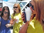 Summer fun! Ariel Winter chows down on a refreshing snow cone as she enjoys a trip the farmers' market with her family
