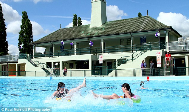 Splashing time: Twin sisters Tammy-Lee and Melissa Fisher aged 12 enjoy the Peterborough Lido swimming pool today