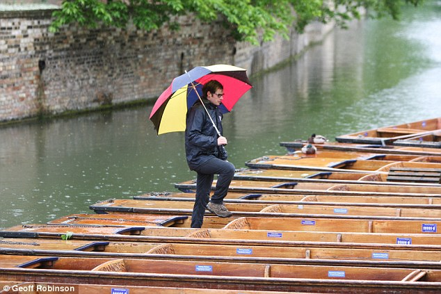 Washout: Punt operators on the River Cam hoping for a sunny start to the long weekend were left disappointed today