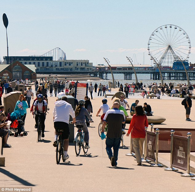 Glorious: Day trippers made their way to Blackpool beach and enjoyed the weather by the sea