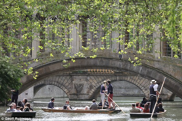 Picturesque: The River Cam was packed with boats as locals took the opportunity to soak up the sunshine on the water