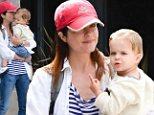 Mummy's boy! Single mother Selma Blair proves that there is only one man for her as she smothers her son with kisses